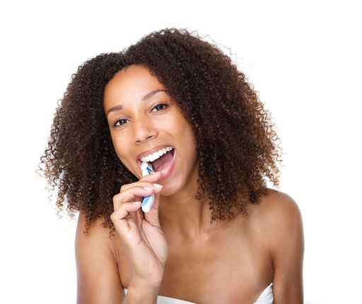 Young black woman brushing teeth
